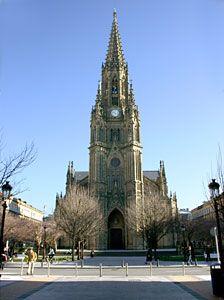 """San Sebastian - Cathedral of El Buen Pastor    Ver mapa más grande CATEDRAL DEL BUEN PASTOR  Construida en el siglo XIX, inaugurada en 1897,  su estética de estilo ojival está inspirada en las iglesias medievales de Alemania y Francia.   Prueba de esa inspiración es la afilada aguja que corona el edificio y que le proporciona la categoría de """"el más alto de San Sebastián"""".     En su fachada principal, destaca  """"La Cruz de la Paz"""", obra del escultor Eduardo Chillida. Con sus 1.915 metros…"""