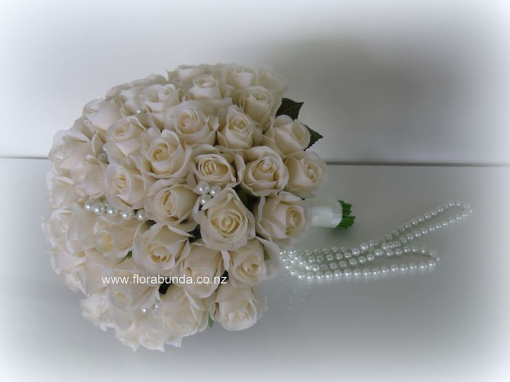 Classic champagne rose buds and pearls. Keep forever!