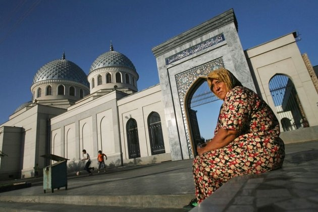 TASHKENT, UZBEKISTAN: An Uzbek woman outside the Juma Mosque in Tashkent in the central Asian country of Uzbekistan. The mosque was built in the 9th century after the Arab invasion of the ancient Zoroastrian Tashkent region.