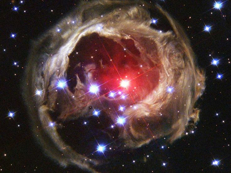 hubble - Star emitting a gust of debris, which reflects back the light.