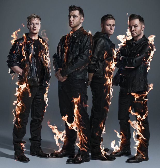 An incredible picture of Westlife on fire. That's because these boys are so damn hot!