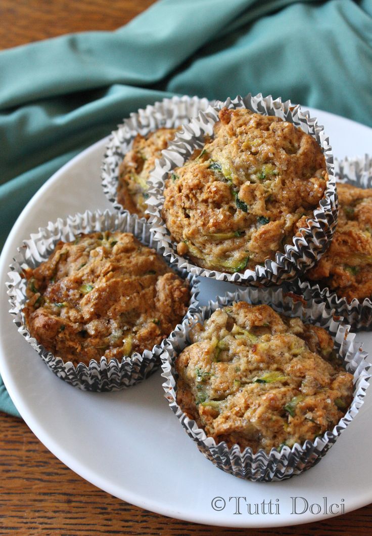 Muffins with Honey as the sweetner and packed with zuchinni and banana