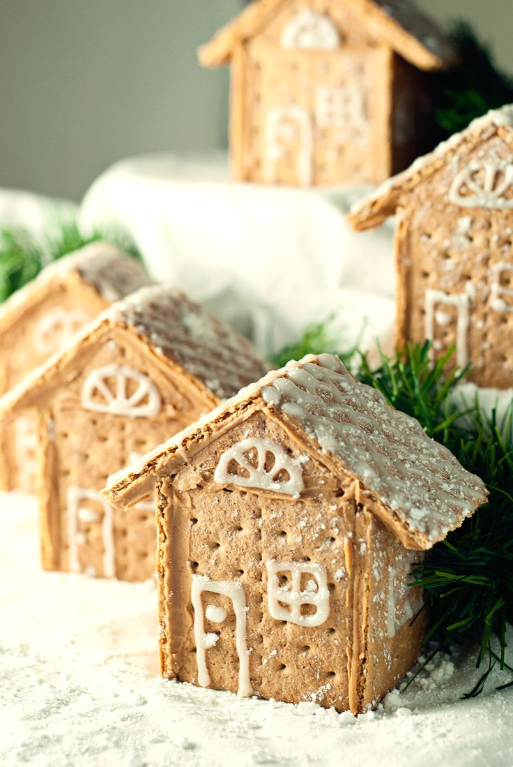 Gorgeous Graham Cracker House Village that is so easy to make with peanut butter and decorated with sparkle gel icing and powdered sugar!:
