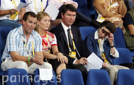 The Princess Royal, Princess Anne, looks at a piece of paper held by her husband, Tim Laurence, as they, her son Peter Phillips, and his wife, Autumn, watch the team eventing showjumping phase at the Olympic Equestrian Centre at Shatin in Hong Kong, China. The Great Britain team took bronze.