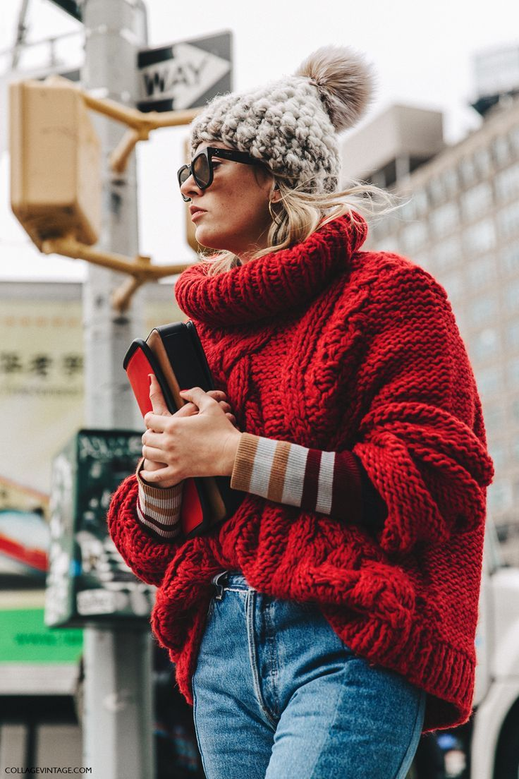 NYFW New York Fashion Week. This Fall Winter Street Style Camille Charriere Vetements. She is wearing  Jeans with a big handknitted red Sweater.