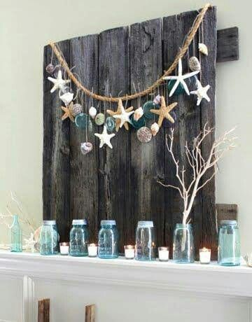 A summer mantel using a garland made from seashells  starfish  rope and  vintage mason jar lids  strung across barn wood makes for perfect summer  decorating. 1686 best images about Coastal Living   Home Decor on Pinterest