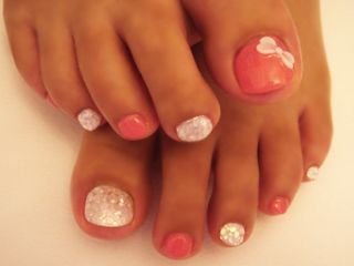 Pink and white glitter pedicure