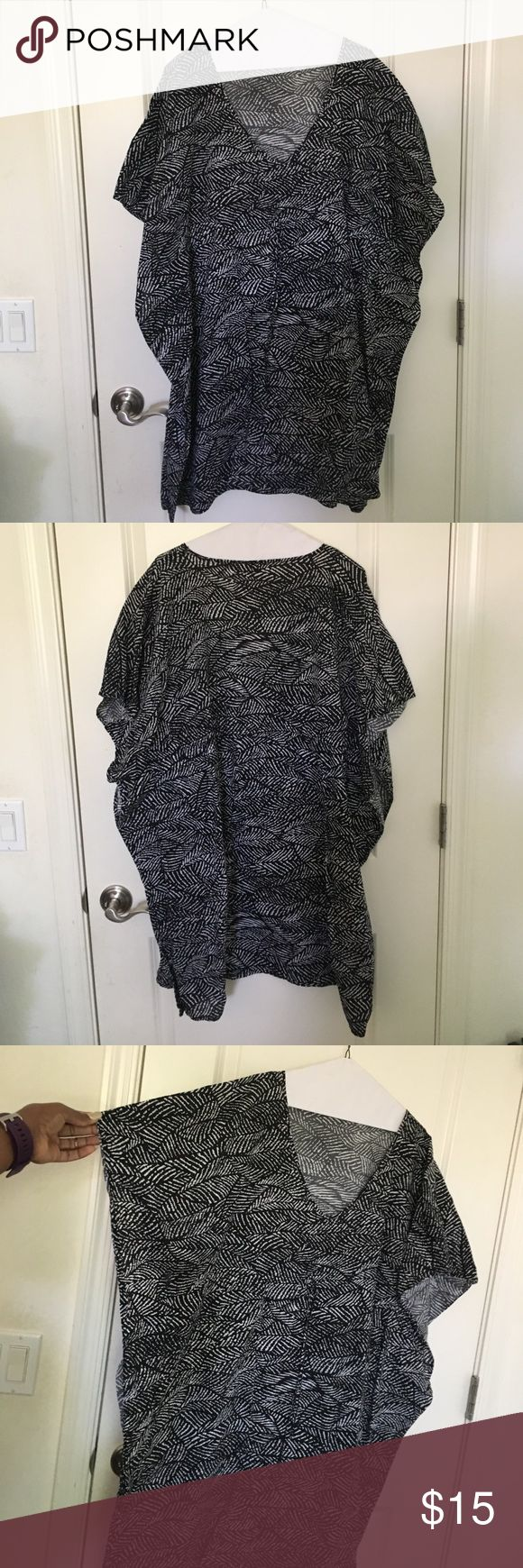 Black and white mini dress/blouse V-neck dress. It's supposed to be maternity but I wore for non maternity and it was beautiful. Has a built in belt. Liz Lange for Target Dresses Mini