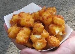 Wisconsin is known for cheese, but unless you've been there or anywhere in the Upper Midwest, you probablyhavenot had the sinful pleasure of eating fried cheese curds. These hot little numbers are made from the solid parts of soured milk, or basically young cheddar cheese in its natural, random shape...