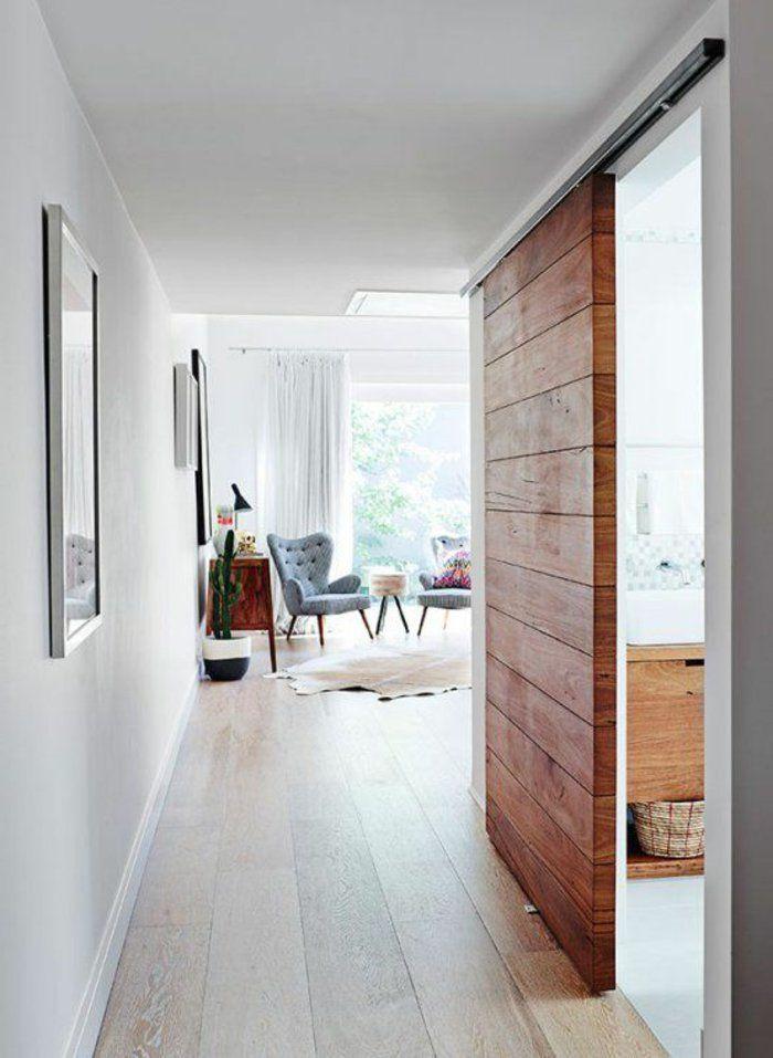 porte à galandage en bois pour separer la chambre a coucher du salon