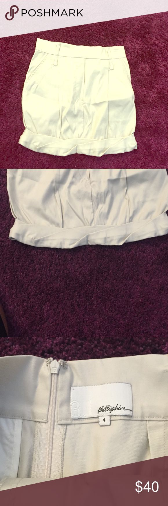 THANKSGIVING SALE! Phillip Lim khaki skirt This skirt is easily dressed up or down and has a unique twisted hem. In great condition. 3.1 Phillip Lim Skirts