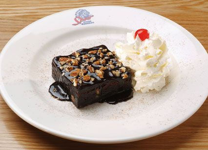 American-style chocolate fudge brownie sprinkled with pecan nuts at Spur Steak Ranches   http://www.spur.co.za/menu/desserts