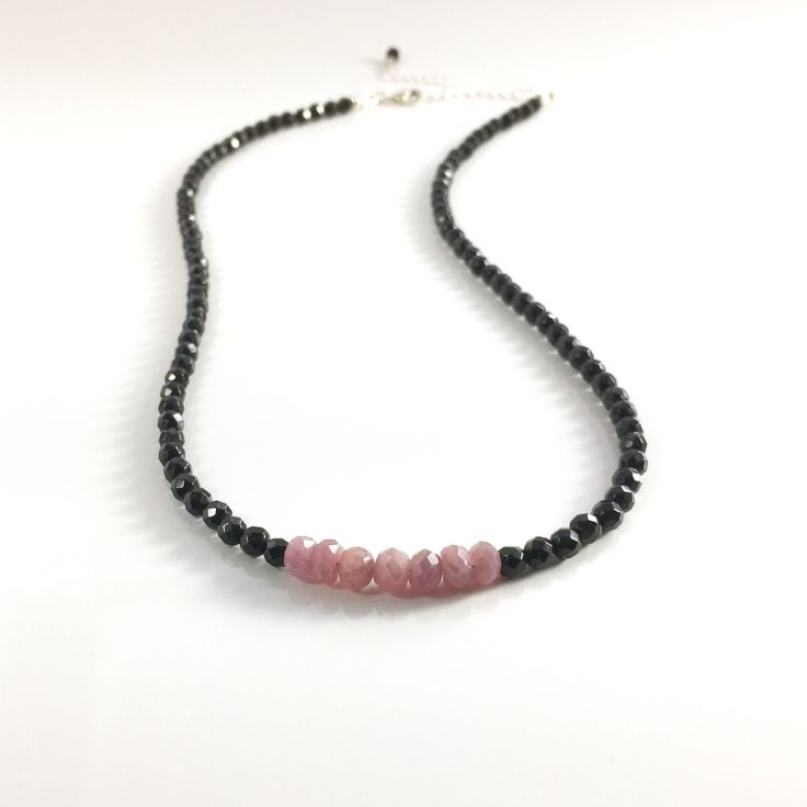 Ruby and Black Onyx are combined in this strong piece which was made with the intention to protect the wearer from negativity while grounding the wearer in love.  Black Onyx helps heal old wounds, release bad habits and promotes wise decision making.  It is associated with the Root Chakra.  Ruby is