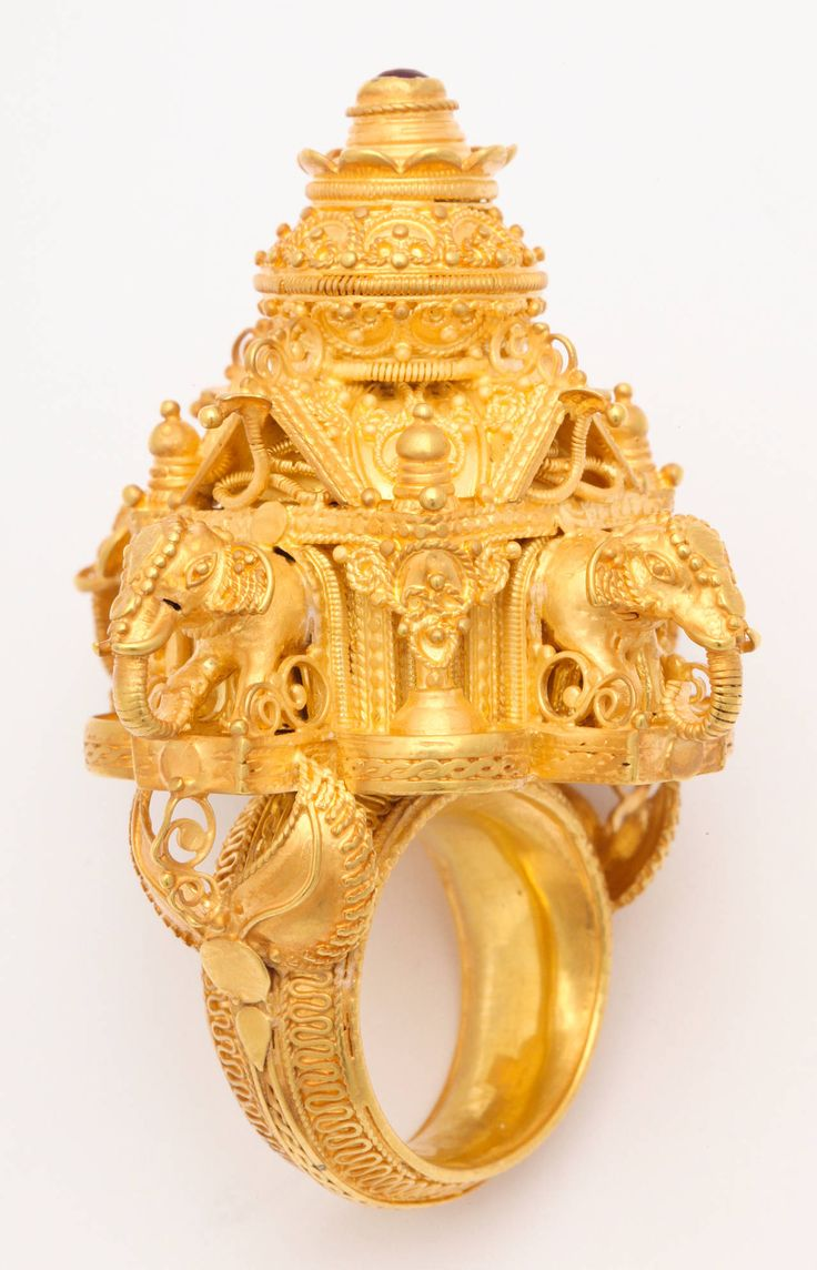 Gold Indian Elephant Temple Ring | From a unique collection of vintage cocktail rings at https://www.1stdibs.com/jewelry/rings/cocktail-rings/