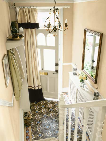 Block drafts and highlight the entry with a curtain on the inside of the front door.   Photo: Mark Scott/IPC Images   thisoldhouse.com