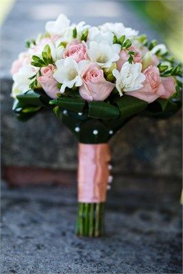 Ivory freesia and light pink rose bouquet.