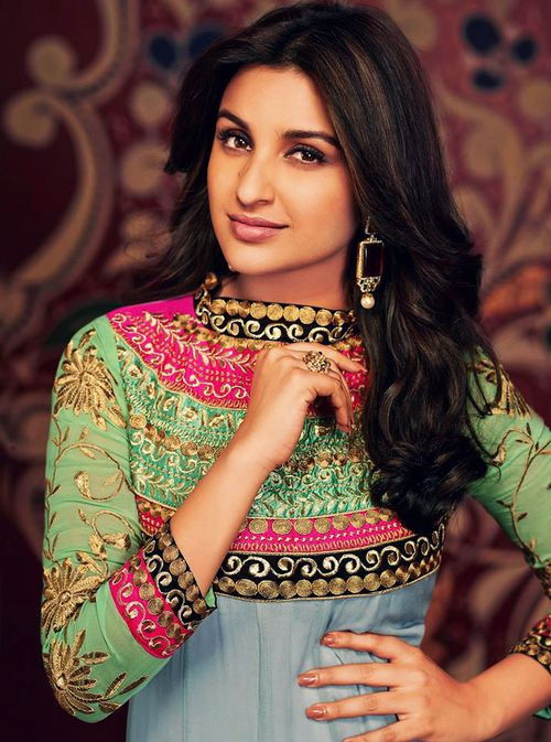 Green, pink, black and pale blue, interwoven with gold. Parineeti chopra in a lovely outfit for Siyarams. #indian #wedding