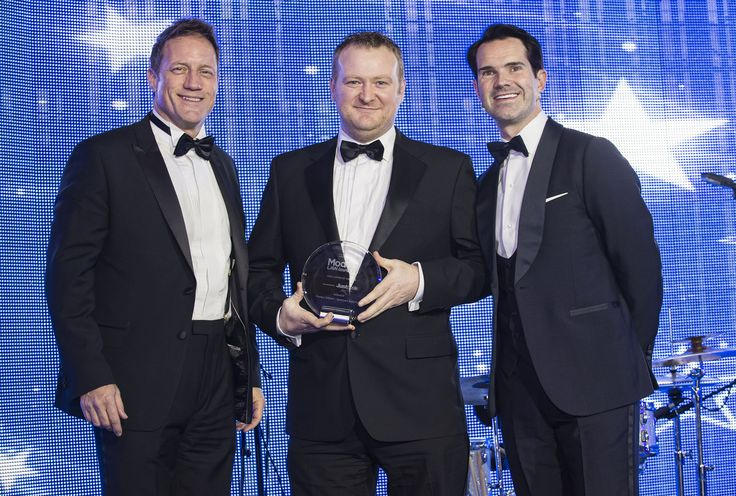 Martyn Gilbert, with Jimmy Carr and Mark Hartigan being prsented with award