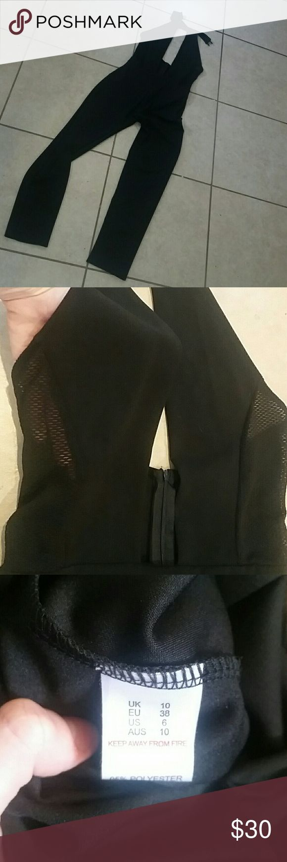 Misguided black turtle neck romper Misguided black size 6 romper with mesh side detail on the top, deep V neck front, turtle neck top with buttons and open back. Zipper in the back. Never worn missing tags. misguided  Pants