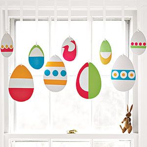 """A valance made from paper eggs embellished with dots, stripes, and fanciful shapes."""