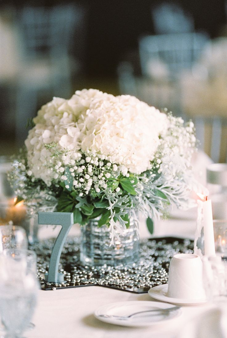 Babys Breath and White Hydrangea Centerpiece   photography by http://www.kristinlavoiephotography.com