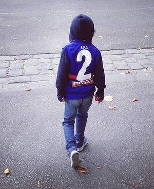 """Would you like to play football like dad one day mate?''  ''Um yeah. But dad, do you know what I really want to do? When I grow up I want to catch lizards and frogs!''"