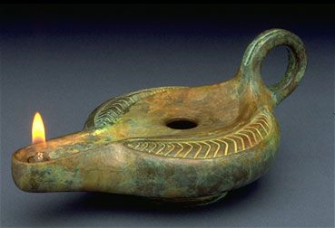 """Pottery oil lamp similar to those that Lhennuen and Yugho would have used in """"You Made My Heart a Hunter"""" (http://www.emepps.com/ymmhah.html)"""
