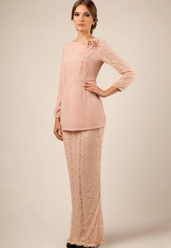 Baju kurung moden with beaded shoulder.