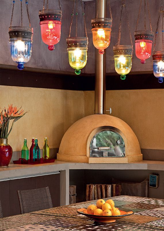 Pizza oven in the kitchen is great, but I can't stop staring at the colorful lamps above.