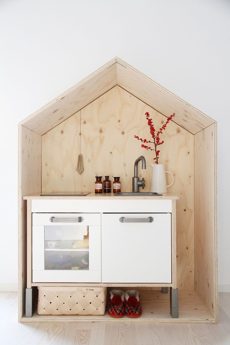 Ikea playkitchen in a wooden house. I wish MY kitchen was this stunning, and compact.
