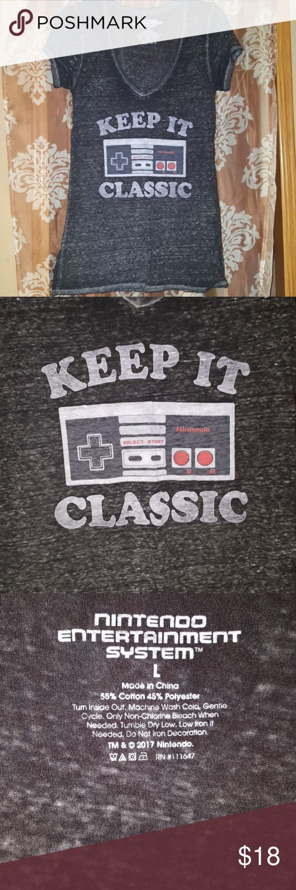 NWT Nintendo Licensed Retro Classic Tee Brand NEW with Tags!! Super Soft Nintendo tee with the old school NES controller on the front thatbwas Keep it Classic. Black/Gray Distressed look This top is ridiculously soft!! Nintendo Tops Tees - Short Sleeve
