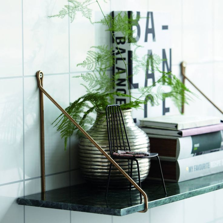 Both elegant and versatile, this marble shelf can be used anywhere in the home.Due to it's size and simplicity, this shelf is ideal for a narrow hall or cloak room. To care for this Marble Shelf please wipe clean with a damp cloth. Due to the natural mable, colour and veining will vary so each shelf is unique. The brass shelf supports are available to buy seperately. Please see our related products.100% marble.W70 x D24cm, 14kg
