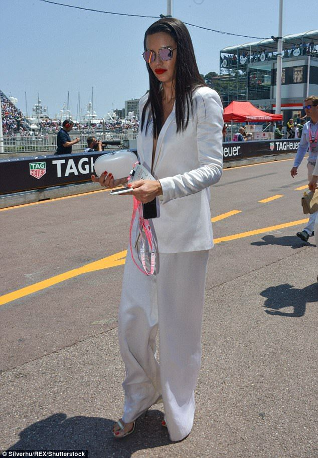 White hot: She teamed the jacket with a pair of loose fitting white trousers, boosting her height with a pair of silver heels