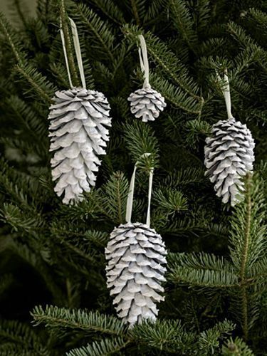 Spray-painted white, pinecones really pop against evergreen boughs for any Christmas ornaments.