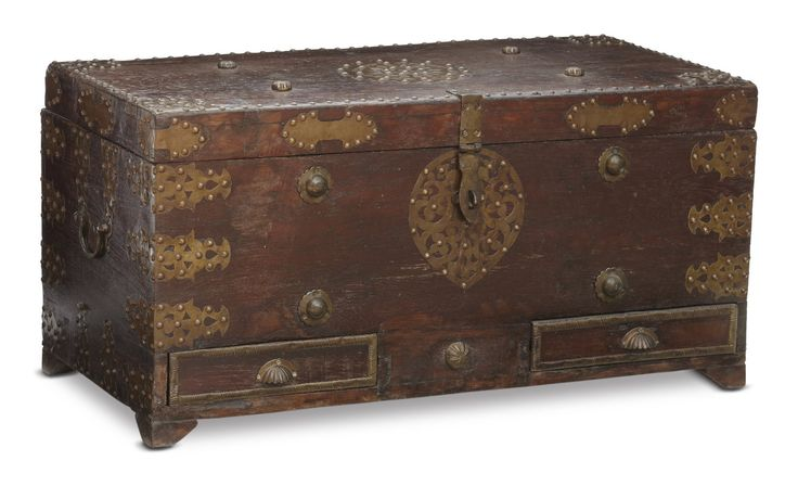 This wooden chest is simple in construction - its frame of solid wood features clean lines and is devoid of carved or metal ornamentation.#Jodhpur, #Rajasthan, #20thCentury
