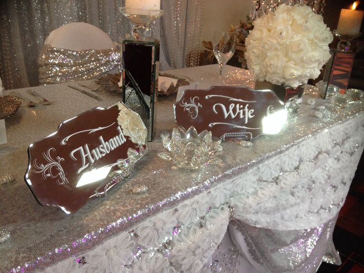 Mirrored table signs , crystal drapes