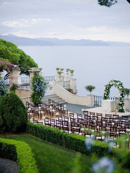 The stunning sea views and floral arch complete this Italian wedding setting