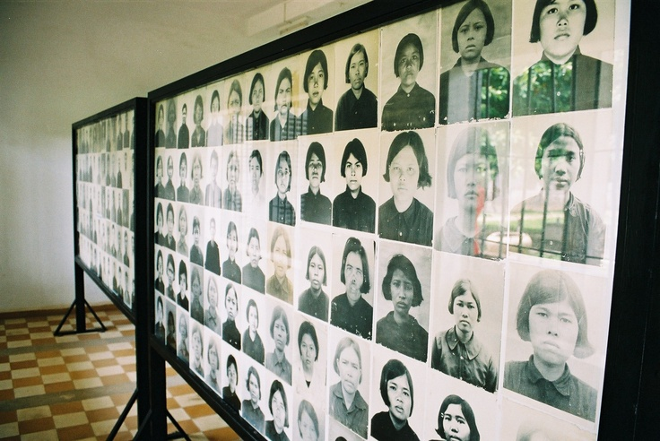 Display board at Tuol Sleng Genocide Museum showing some of the victims that were photographed when they first entered the prison.