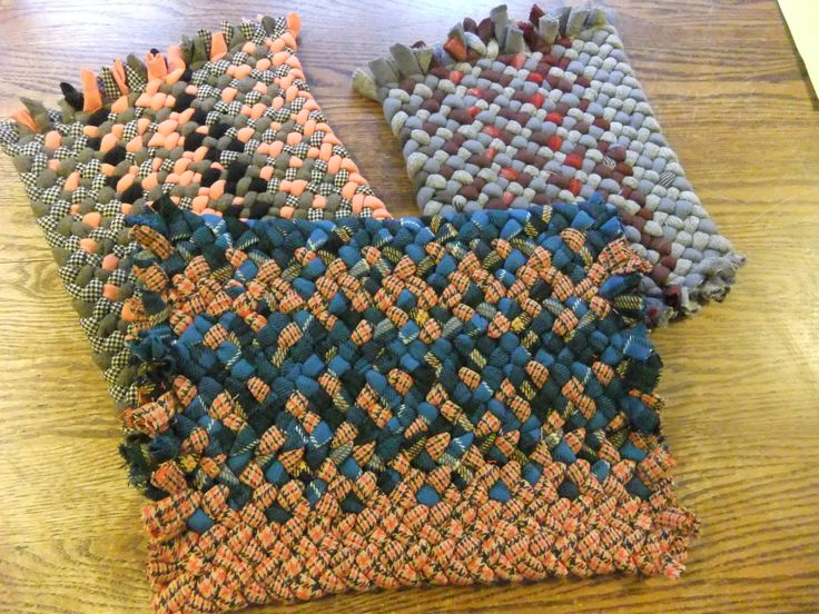 hand braided by Val Galvin, Renditions in Rags, using recycled /reclaimed wool and wool blends. Rectangles with fringe.