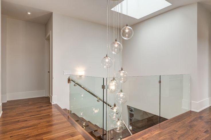 Contemporary Upper Landing by Johnson & Associates Interior Design