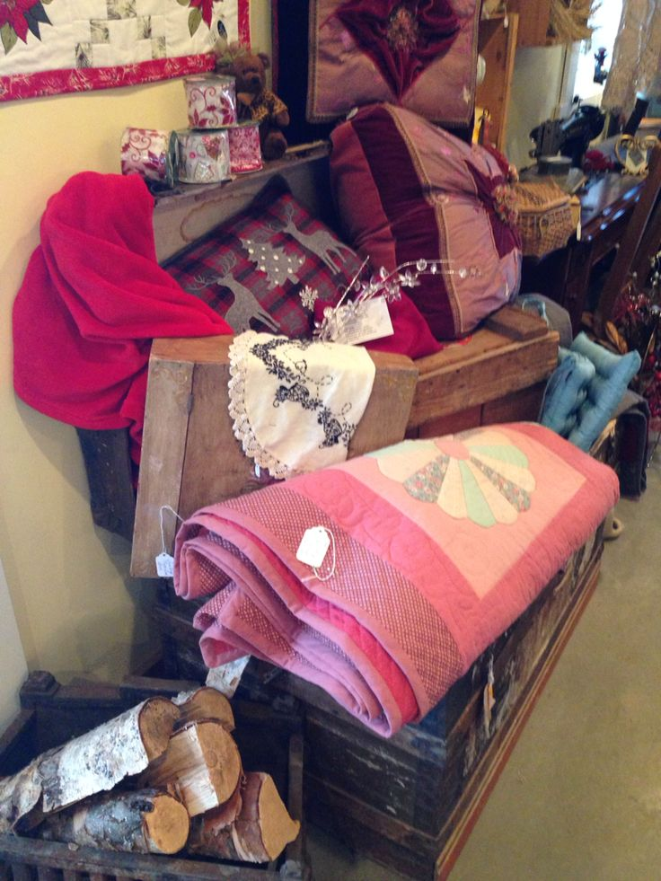 Trunks, boxes, handstitched quilts n pillows just got together