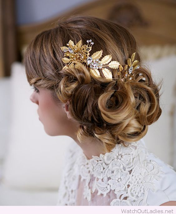 Low bun from curls with an awesome accessory