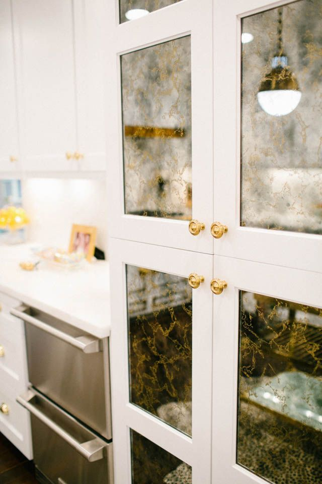 Mercury-glass(?)-front kitchen cabinets