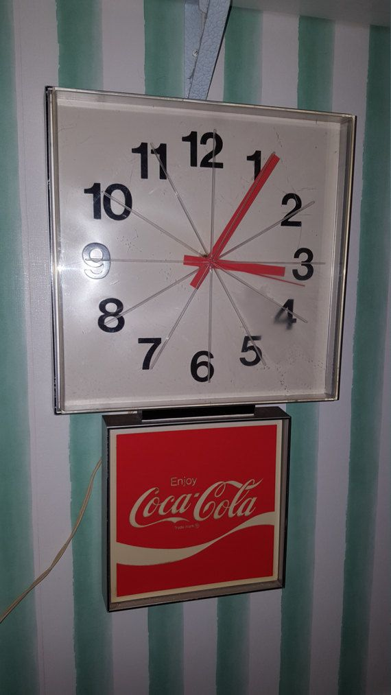 Vintage Coca Cola 1970s wall mount electric plug in wall clock. Working condition. Slight wear on plastic face cover. Damage to plastic wall mount housing. Cracked and broken off. Clock dimensions are approximately21 by 12.5 Please note at all shipping costs are estimates. Packaging