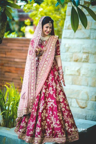 Bridal Plum and Gold Embroidered Wedding Lehenga with Light Pink Net Dupatta.