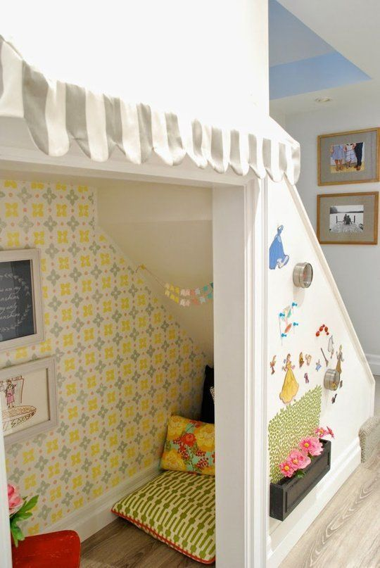 Wallpaper or stencil the wall under your stairs for reading nook, closet, office space.