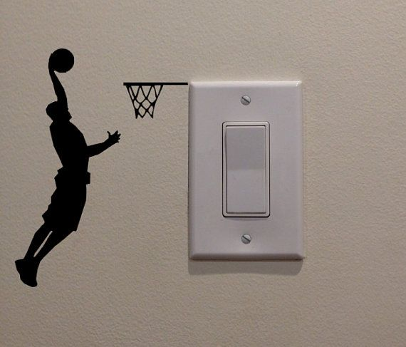 Athletic Basketball Player Dunking on Light by DecalPhanatics