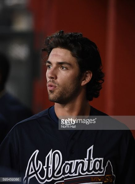News Photo : Dansby Swanson of the Atlanta Braves prepares for...