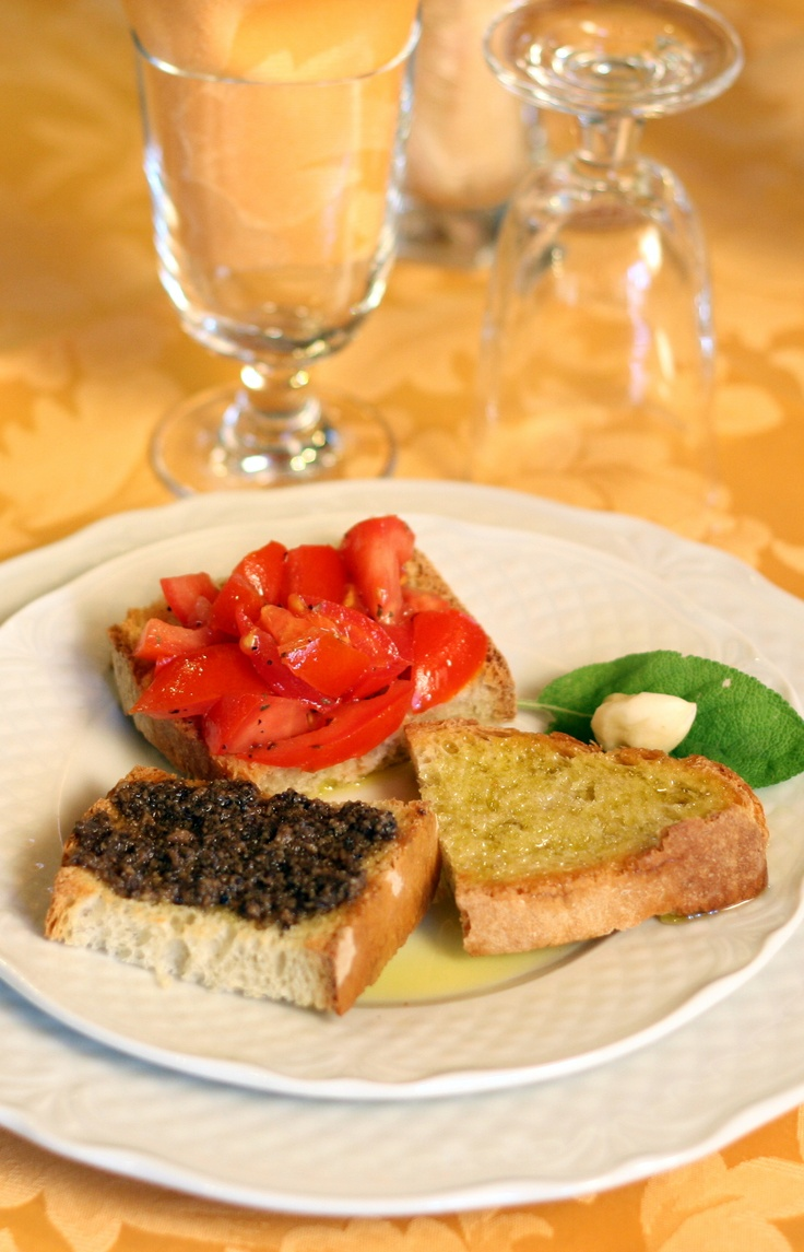 Bruschetta with fresh tomatoes, truffles and extra virgin olive oil. This is the way to a man's heart. <3