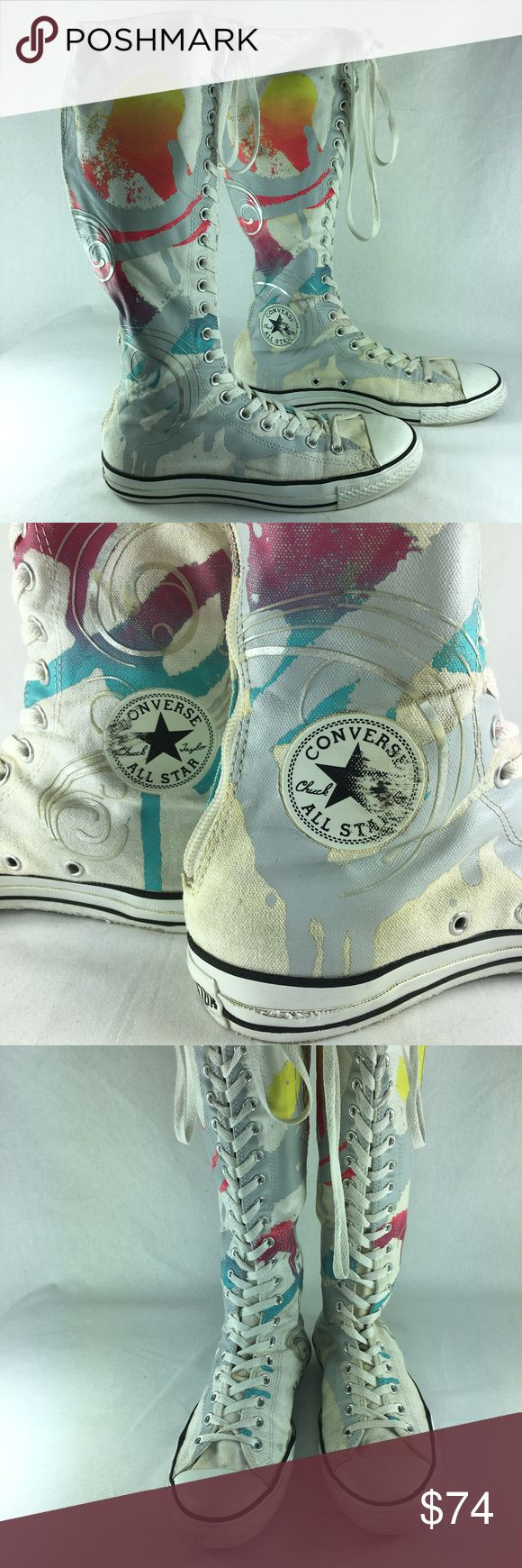 Converse CT Swirl XX Hi Top Knee High Sneakers Converse All Star Chuck Taylor CT Swirl XXHi sneakers in white/multi. Women's Size 10, men's Size 8, EUR Size 41.5. Canvas knee-high sneakers lace up the front and zip up the back. Off white ground with silver metallic swirls and a paint splatter graffiti print. Very good pre-owned condition with light wear. All Star patches at ankles are smudged and worn as is All Star logo on heels. Canvas has a few smudges near the rims.  Sneakers measure…